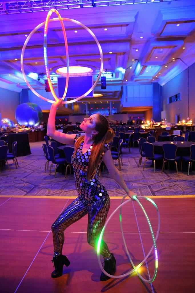 LED Hula hoop entertainment in futuristic costume for corporate gala