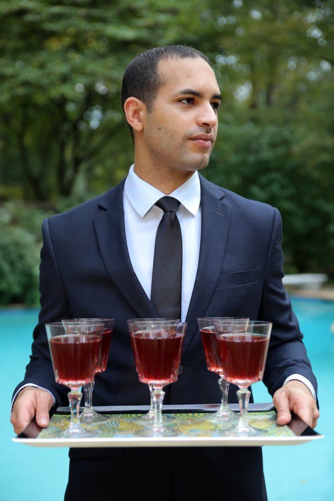 ARTSTELLA male model serving wine